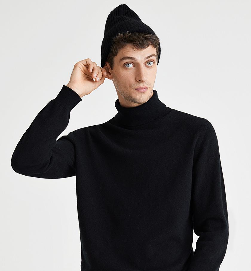 man wearing black cashmere hat and black cashmere jumper