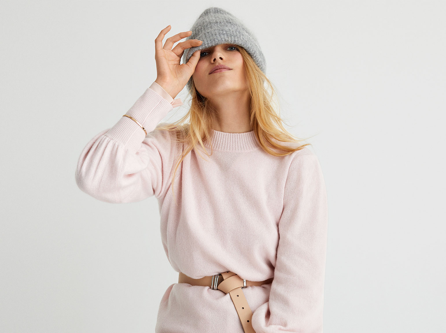 woman in nude cashmere jumper