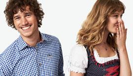 Mann und Frau in Lederhose und Dirndl, die miteinander lachen